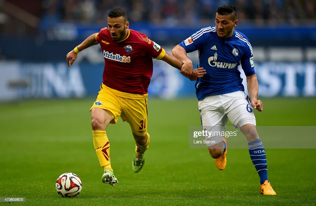 Suleyman Koc of SC Paderborn is challenged by Sead Kolasinac of Schalke 04 during the Bundesliga match between FC Schalke 04 and SC Paderborn at Veltins Arena on May 16, 2015 in Gelsenkirchen, Germany.