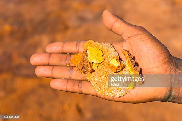 sulfuric crystals on human hand - danakil depression stock pictures, royalty-free photos & images