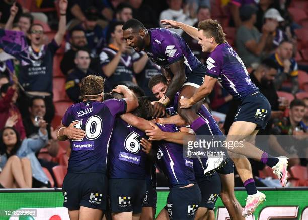 Suliasi Vunivalu and Ryan Papenhuyzen of the Storm of the Storm celebrate after Jesse Bromwich of the Storm scored a try during the NRL Qualifying...
