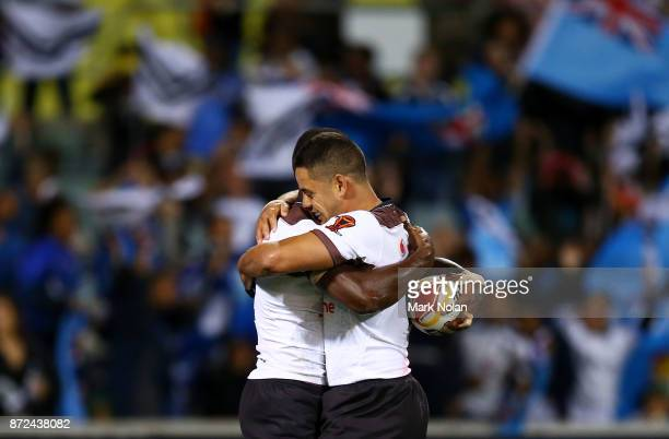 Suliasi Vunivalu of Fiji celebrates his try with team mate Jarryd Hayne during the 2017 Rugby League World Cup match between Fiji and Italy at...