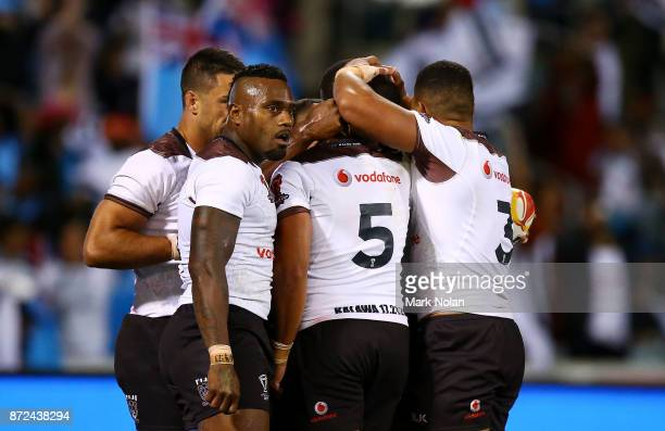 Suliasi Vunivalu of Fiji celebrtaes one of his tries with team mates during the 2017 Rugby League World Cup match between Fiji and Italy at Canberra...