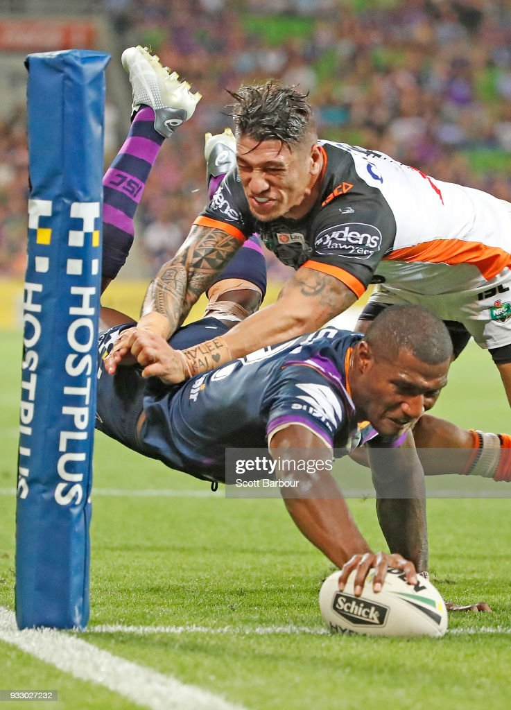 Suliasi Vunivalu of the Melbourne Storm dives to score a try during the round two NRL match between the Melbourne Storm and the Wests Tigers at AAMI Park on March 17, 2018 in Melbourne, Australia.