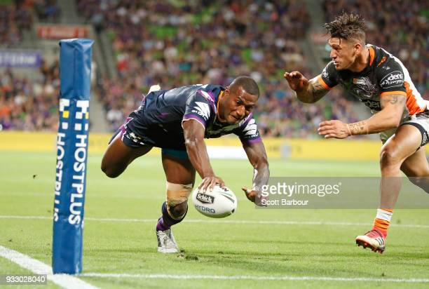 Suliasi Vunivalu of the Melbourne Storm dives to score a try during the round two NRL match between the Melbourne Storm and the Wests Tigers at AAMI...