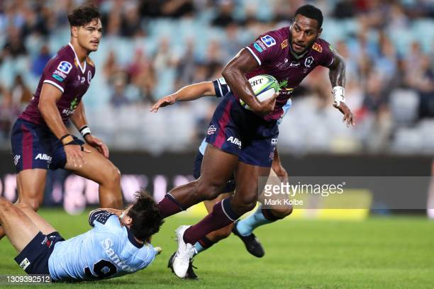Suliasi Vunivalu of the Reds is tackled during the round 6 Super RugbyAU match between the NSW Waratahs and the Queensland Reds at Stadium Australia,...
