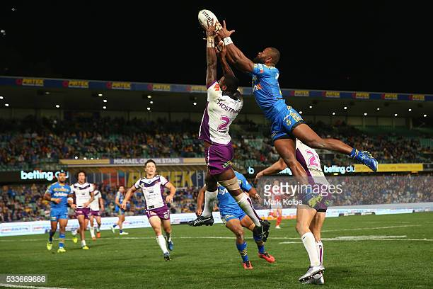 Suliasi Vunivalu of the Storm and Semi Radradra of the Eels compete for the ball from a kick during the round 11 NRL match between the Parramatta...