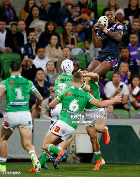 Suliasi Vunivalu of the Storm brings down a high ball to score a try during the NRL Qualifying Final match between the Melbourne Storm and the...