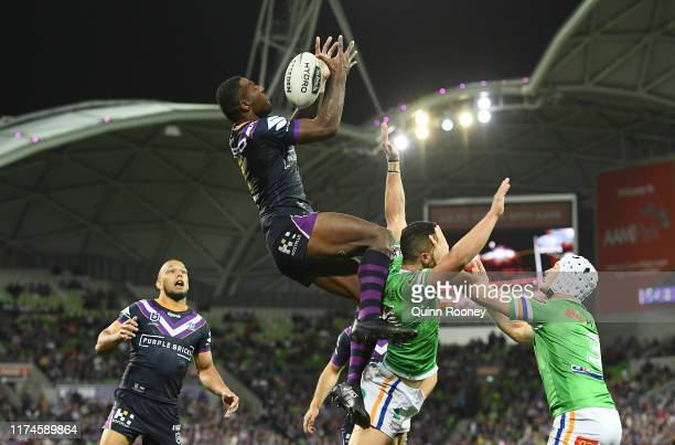 Suliasi Vunivalu of the Storm catches the ball and scores a try during the NRL Qualifying Final match between the Melbourne Storm and the Canberra...