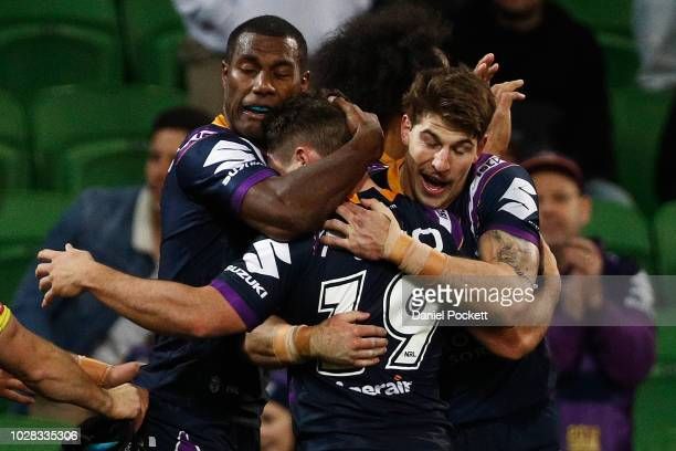 Suliasi Vunivalu of the Storm celebrates a try with Brodie Croft of the Storm and Curtis Scott of the Storm during the NRL Qualifying Final match...