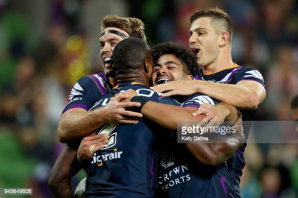 Suliasi Vunivalu of the Storm celebrates his try with team mates during the round six NRL match between the Melbourne Storm and the Newcastle Knights...