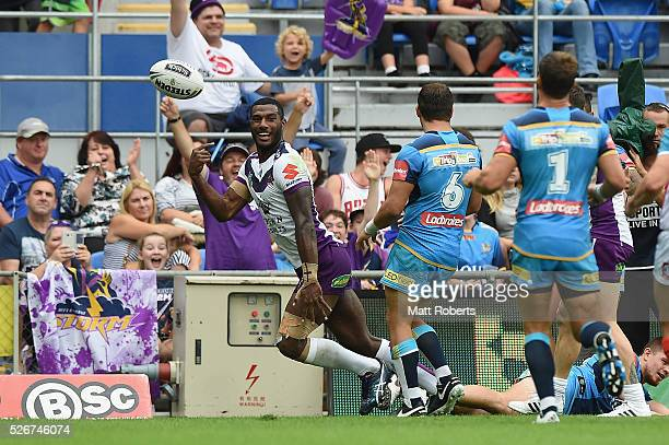 Suliasi Vunivalu of the Storm celebrates scoring a try during the round nine NRL match between the Gold Coast Titans and the Melbourne Storm on May 1...
