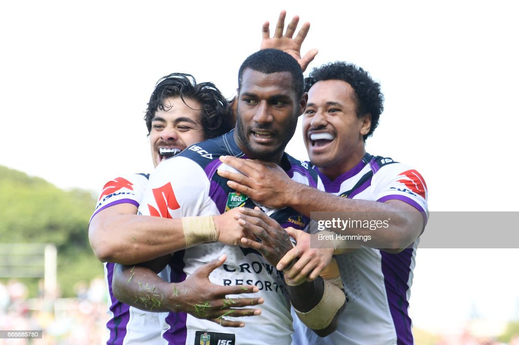Suliasi Vunivalu of the Storm celebrates scoring a try with team mates during the round seven NRL match between the Manly Sea Eagles and the Melbourne Storm at Lottoland on April 15, 2017 in Sydney, Australia.