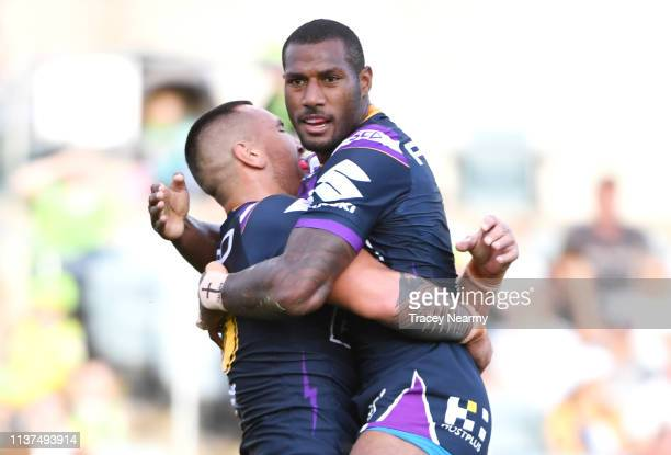 Suliasi Vunivalu of the Storm flys through the air as he scores a try during the round two NRL match between the Canberra Raiders and the Melbourne...