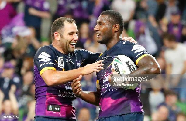 Suliasi Vunivalu of the Storm is congratulated by Cameron Smith after scoring a try during the World Club Challenge match between the Melbourne Storm...