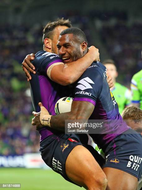 Suliasi Vunivalu of the Storm is congratulated by his teammates after scoring a try during the round 26 NRL match between the Melbourne Storm and the...