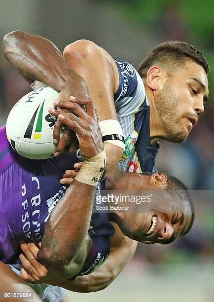 Suliasi Vunivalu of the Storm is tackled by Antonio Winterstein of the Cowboys during the NRL Qualifying Final match between the Melbourne Storm and...