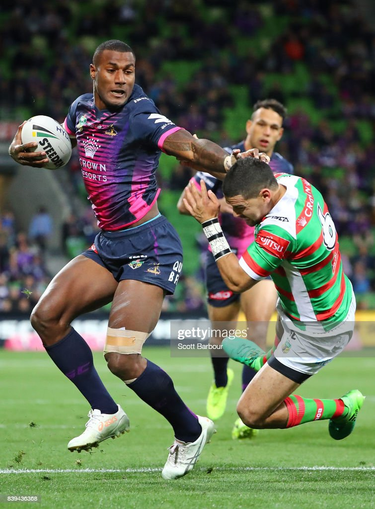 Suliasi Vunivalu of the Storm is tackled by Cody Walker of the Rabbitohs during the round 25 NRL match between the Melbourne Storm and the South Sydney Rabbitohs at AAMI Park on August 26, 2017 in Melbourne, Australia.