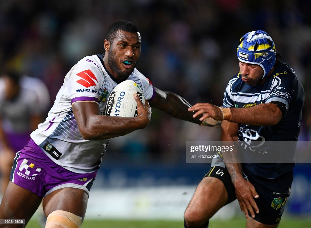 Suliasi Vunivalu of the Storm is tackled by Johnathan Thurston of the Cowboys during the round 12 NRL match between the North Queensland Cowboys and the Melbourne Storm at 1300SMILES Stadium on May 25, 2018 in Townsville, Australia.