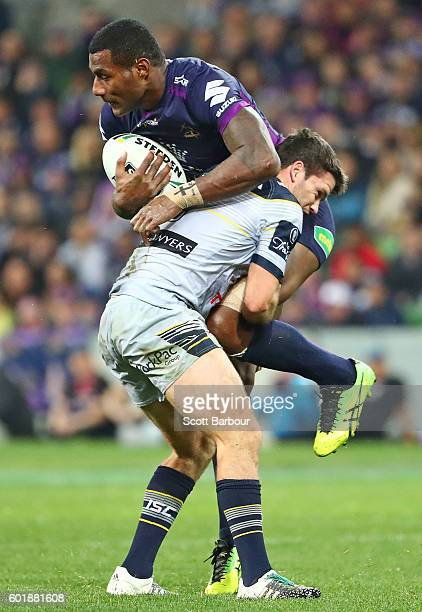 Suliasi Vunivalu of the Storm is tackled by Lachlan Coote of the Cowboys during the NRL Qualifying Final match between the Melbourne Storm and the...