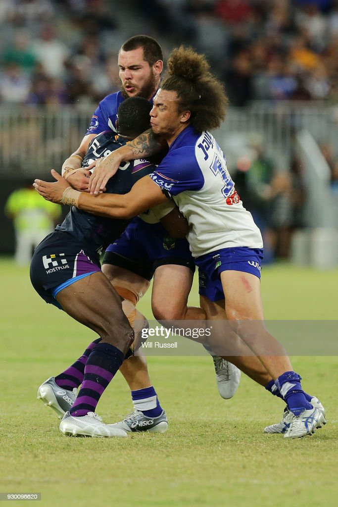 Suliasi Vunivalu of the Storm is tackled by Raymond Faitala-Mariner of the Bulldogs during the round one NRL match between the Canterbury Bulldogs and the Melbourne Storm at Optus Stadium on March 10, 2018 in Perth, Australia.