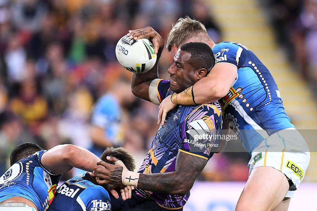 Suliasi Vunivalu of the Storm looks to offload the ball during the round ten NRL match between the Melbourne Storm and the Gold Coast Titans at Suncorp Stadium on May 12, 2018 in Brisbane, Australia.