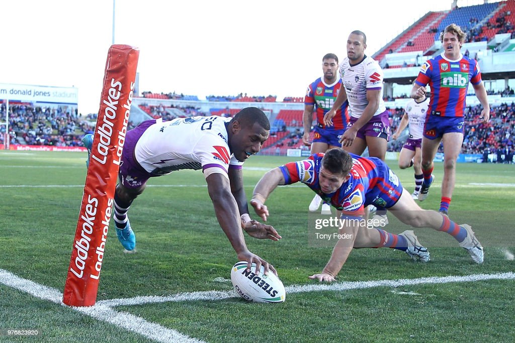 Suliasi Vunivalu of the Storm scores a try during the round 15 NRL match between the Newcastle Knights and the Melbourne Storm at McDonald Jones Stadium on June 17, 2018 in Newcastle, Australia.