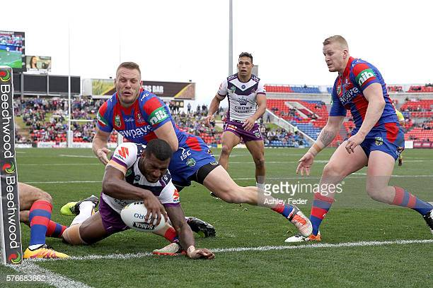 Suliasi Vunivalu of the Storm scores a try during the round 19 NRL match between the Newcastle Knights and the Melbourne Storm at Hunter Stadium on...