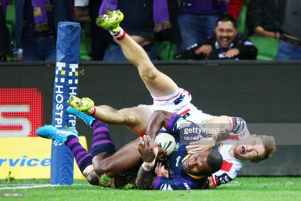 Suliasi Vunivalu of the Storm scores a try past Matt Dufty of the Dragons during the round 17 NRL match between the Melbourne Storm and the St George Illawarra Dragons at AAMI Park on July 5, 2018 in Melbourne, Australia.