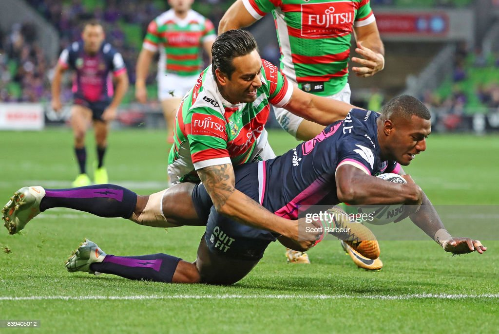 Suliasi Vunivalu of the Storm scores the first try of the match during the round 25 NRL match between the Melbourne Storm and the South Sydney Rabbitohs at AAMI Park on August 26, 2017 in Melbourne, Australia.