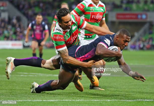 Suliasi Vunivalu of the Storm scores the first try of the match during the round 25 NRL match between the Melbourne Storm and the South Sydney...