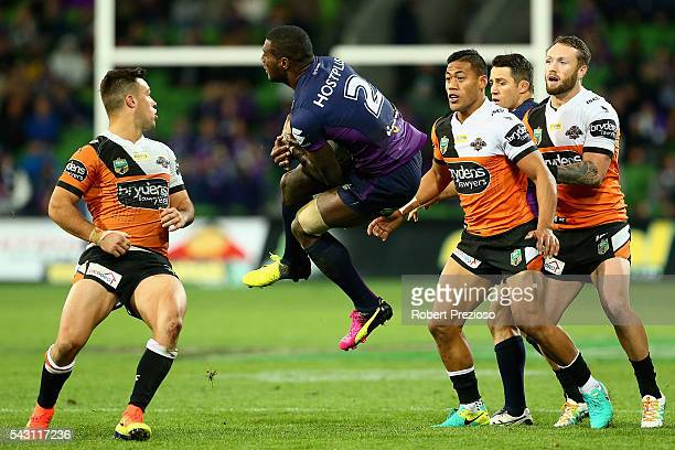 Suliasi Vunivalu of the Storm takes a high ball during the round 16 NRL match between the Melbourne Storm and Wests Tigers at AAMI Park on June 26...
