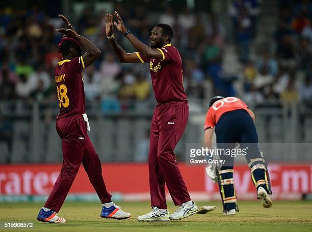 Sulieman Benn of the West Indies celebrates with Darren Sammy after dismissing Alex Hales of England during the ICC World Twenty20 India 2016 Super...
