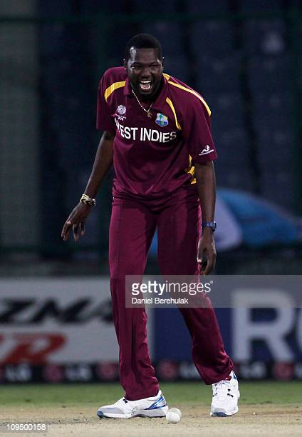 Sulieman Benn of West Indies celebrates the wicket of Ryan ten Doeschate of the Netherlands during the 2011 ICC World Cup group B match between...