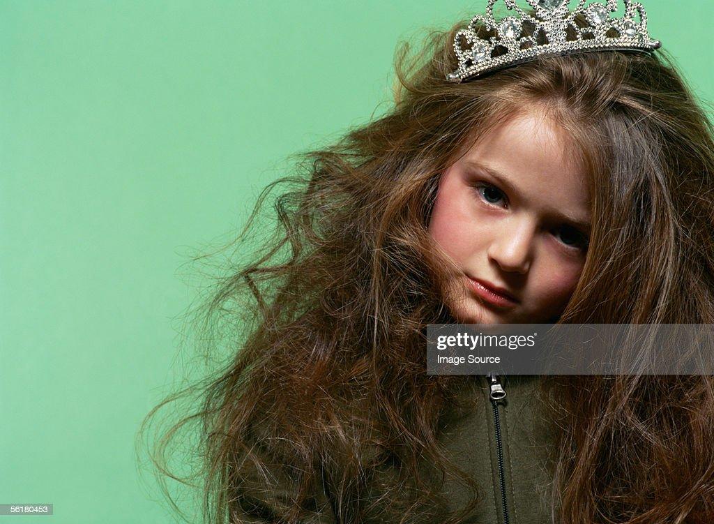 Sulky girl wearing a tiara : Stock Photo