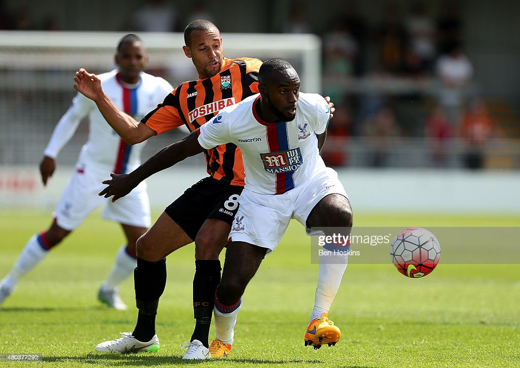 Sullay Kaikai of Crystal Palace holds off pressure from Curtis Weston of Barnet during a Pre Season Friendly between Barnet and Crystal Palace at The Hive on July 11, 2015 in Barnet, England.