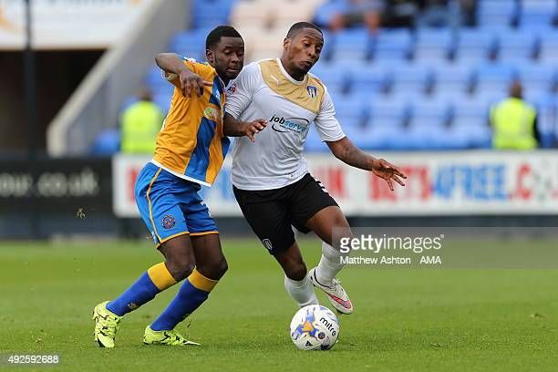 Sullay Kaikai of Shrewsbury Town and Matthew Briggs of Colchester United during the Sky Bet League One match between Shrewsbury Town and Colchester...