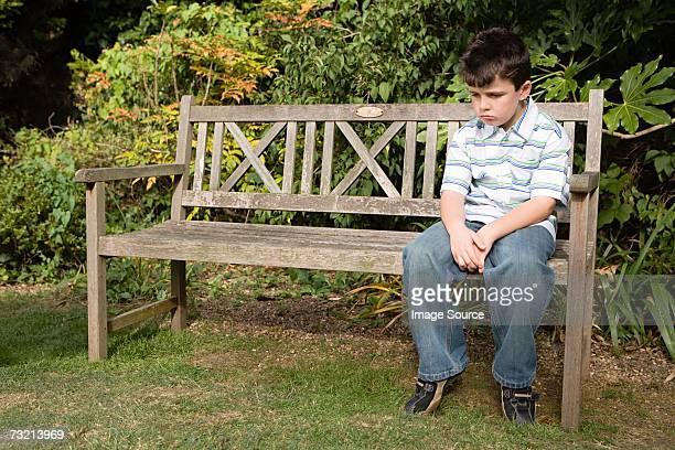 Sullen boy on a bench