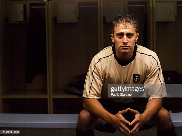 Sullen Soccer Player in the Locker Room