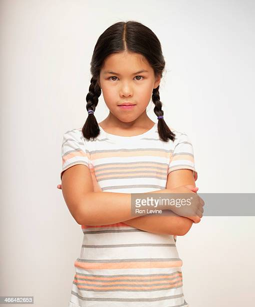 Sullen young girl in striped shirt, portrait