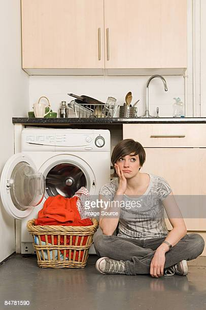 Sullen young woman and laundry