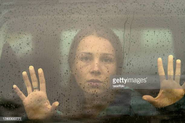 sullen young woman in a car - suicide stock pictures, royalty-free photos & images
