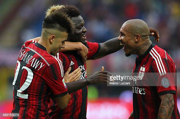 Sulley Ali Muntari of AC Milan celebrates with his team-mates Nigel De Jong and Stephan El Shaarawy after scoring his goal during the Serie A match...