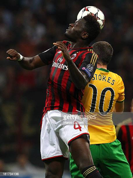 Sulley Ali Muntari of AC Milan competes for the ball with Anthony Stokes of Celtic during the UEFA Champions League group H match between AC Milan...