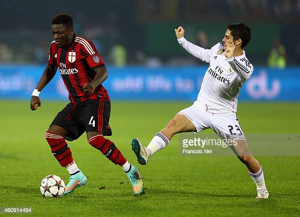 Sulley Ali Muntari of AC Milan holds off Isco of Real Madrid during the Dubai Football Challenge match between AC Milan and Real Madrid at The Sevens...