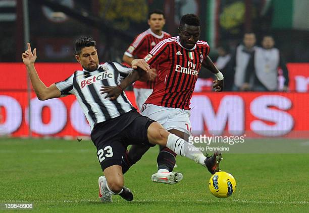 Sulley Ali Muntari of AC Milan is challenged by Marco Borriello of Juventus FC during the Serie A match between AC Milan and Juventus FC at Stadio...