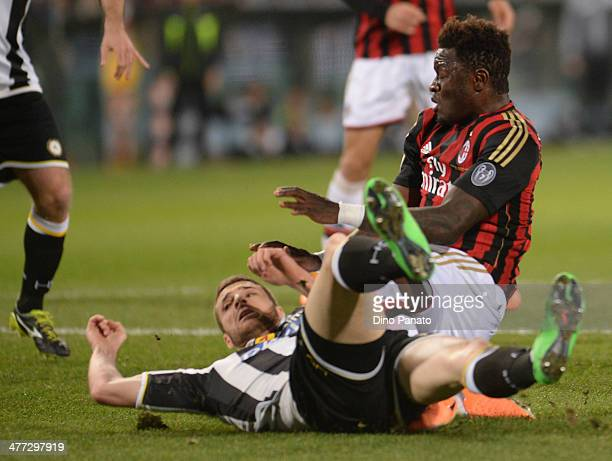 Sulley Ali Muntari of AC Milan is tackled by Thomas Heurtaux of Udinese Calcio during the Serie A match between Udinese Calcio and AC Milan at Stadio...