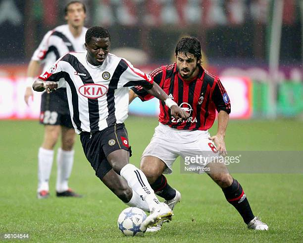 Sulley Ali Muntari of Udinese is pursued by Milan's Gennaro Gattuso during the Serie A match between AC Milan and Udinese at the Giuseppe Meazza, San...