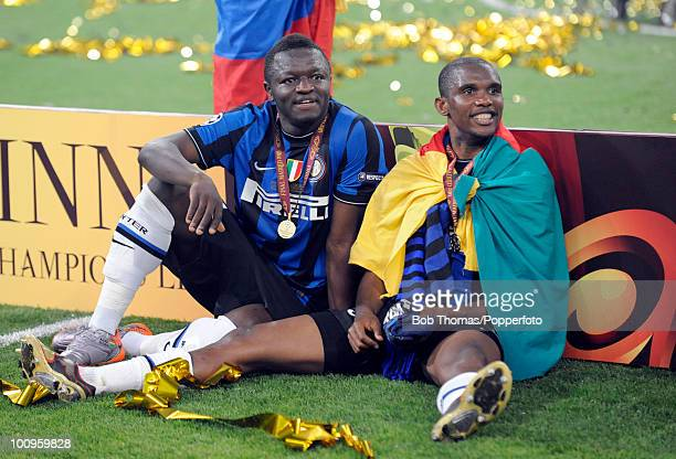 Sulley Muntari and Samuel Eto'o of Inter Milan celebrate after winning the UEFA Champions League Final match between Bayern Munich and Inter Milan at...