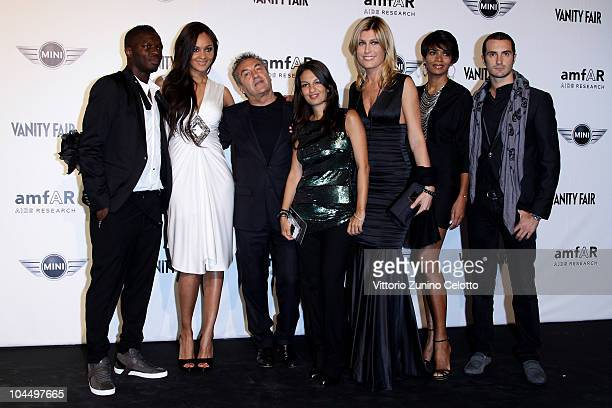 Sulley Muntari Menaye Donkor Saverio Moschillo Alessandra Moschillo Raffaella Zardo Georgette Eto and Alessandro Pera attend amfAR Milano 2010 Red...