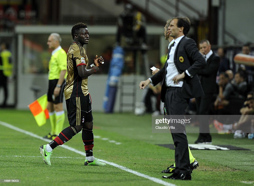 Sulley Muntari of AC Milan (L) is shown the red card during the Serie A match between AC Milan and AS Roma at San Siro Stadium on May 12, 2013 in Milan, Italy.