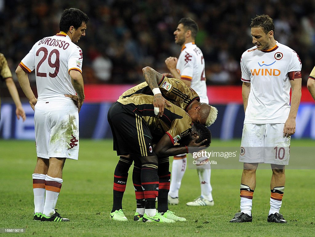 Sulley Muntari of AC Milan (C) is shown the red card during the Serie A match between AC Milan and AS Roma at San Siro Stadium on May 12, 2013 in Milan, Italy.